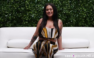 Buxom long haired babe Alexis sucks black dick on the casting couch
