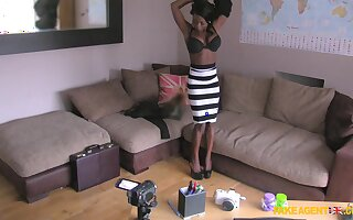 Black babe Kichomi strips and takes a fat white cock in her cunt