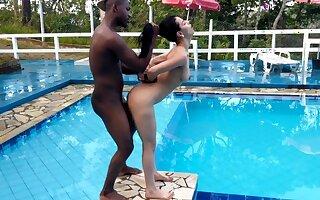 Teenage fucked wits black dick near the pool